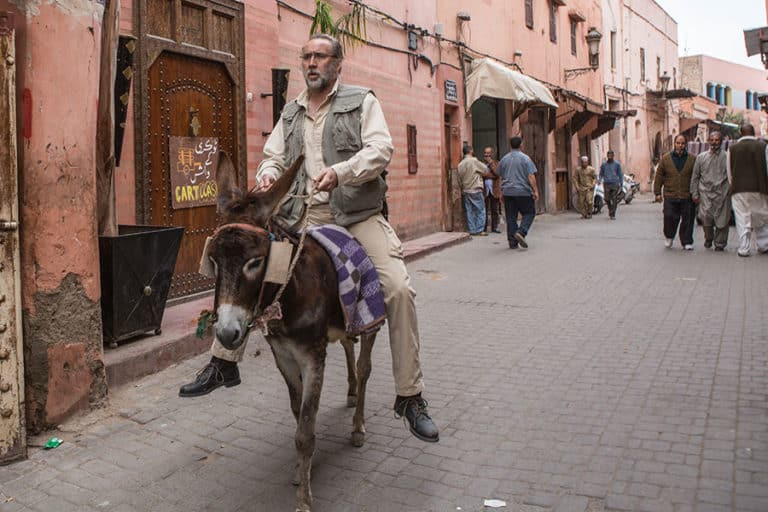 Nicolas Cage ridding a donkey in Marrakech Medina